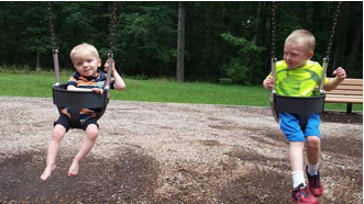 Toby Lear, left, swings with his five-year-old big brother, J.D.